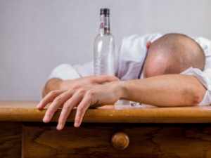Person passed out from alcohol addiction